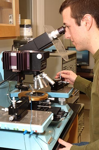 Student operates a microscope.