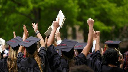 Students celebrate their graduation.