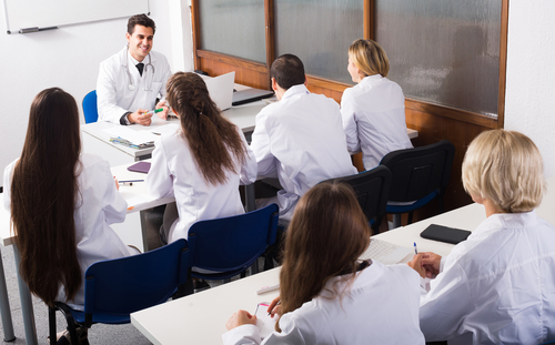 Professor teaches class of medical students.