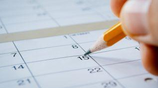 A person marks a calendar.